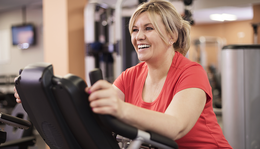 Healthy Resolution | Happy Woman at Gym