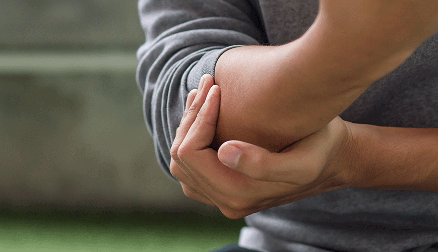 Man with Tennis Elbow Pain
