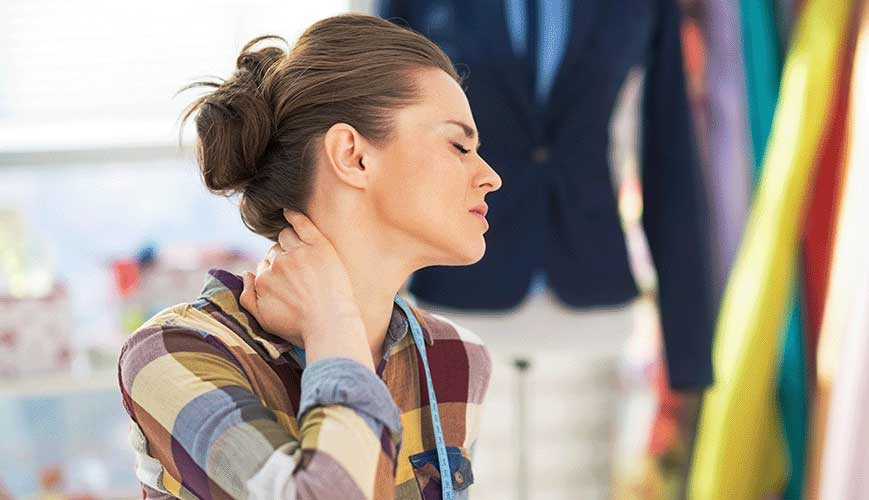 Women Holding Neck Due To Neck Pain