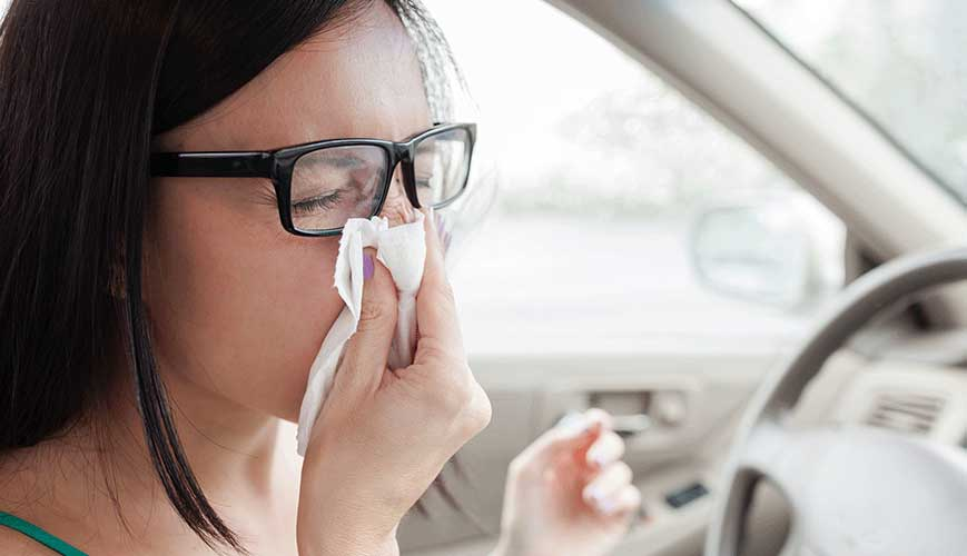 Women Sneezing and Covering Nose due to Seasonal Allergies