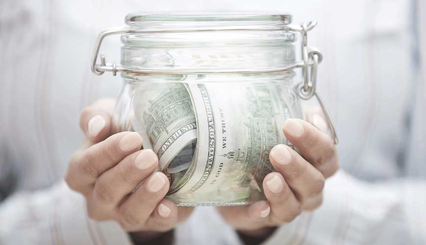 Jar of Saved Money from Reduced Health Care Costs