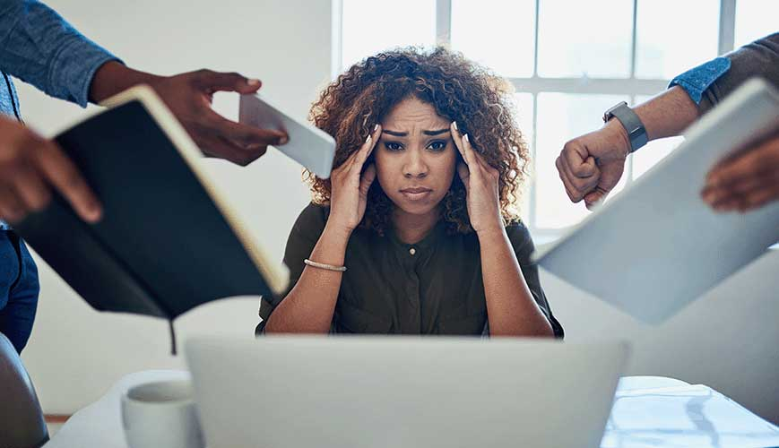 Overwhelmed and Stressed Woman at Office