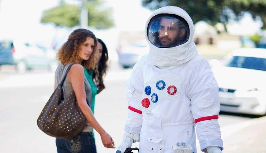 Astronaut Walking Down Street